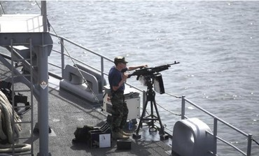 A U.S. Navy officer on the USS Nashville during anti-piracy training for the Nigerian navy.