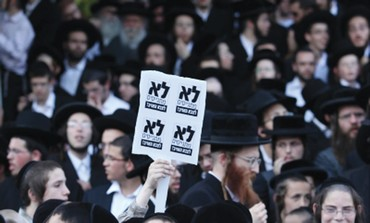 HAREDI DEMONSTRATORS protest in Jerusalem against performing national service.