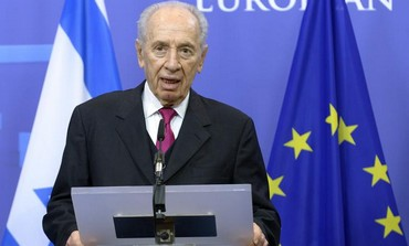 President Shimon Peres talks to EU press conference, March 6, 2013.