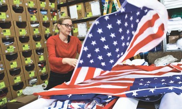 A WORKER at a factory in Kfar Saba arranges US flags ordered ahead of Obama's visit to Israel