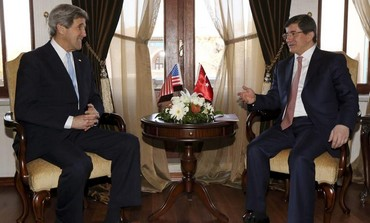 US Secretary of State John Kerry meets with Turkish Foreign Minister Ahmet Davutoglu, March 1, 2013.