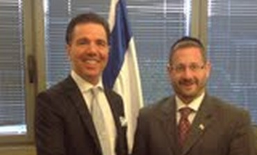 MK Dov Lipman (right) meets with Dr. Oktar Babuna,
