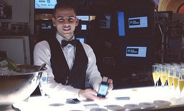 ALCOHOOT COFOUNDER Ben Biron demonstrates the smartphone Breathalyzer