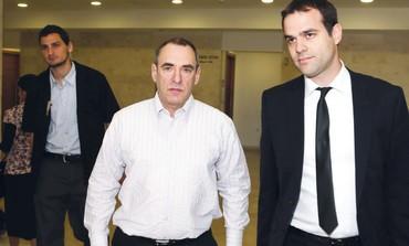 FORMER REMEDIA technologist Frederick Black (center) leaves Petah Tikva Magistrate's Court