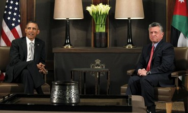 US President Obama sits with Jordanian King in Amman, March 22, 2013.