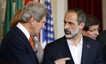 Former Syrian National Coalition President Moaz Alkhatib and US Secretary of State John Kerry.