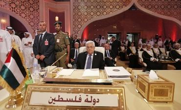 PA President Mahmoud Abbas looks at Arab League summit, Doha