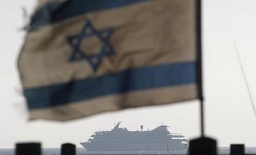 Israeli flag flutters as Mavi Marmara escorted to Ashdod port May 31, 2010.