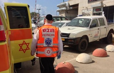 Ambulance at site of woman's death in Netanya