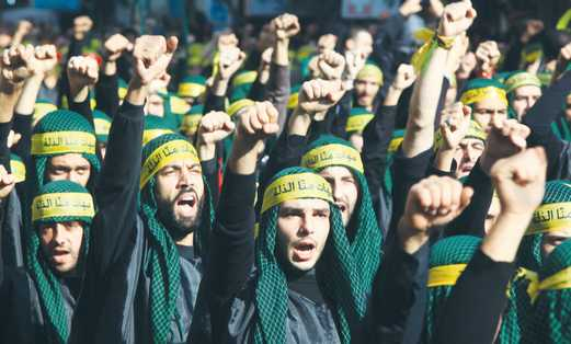 HEZBOLLAH SUPPORTERS march through the streets of Beirut last year.