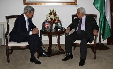 Palestinian President Mahmoud Abbas (R) meets with U.S. Secretary of State John Kerry in Ramallah