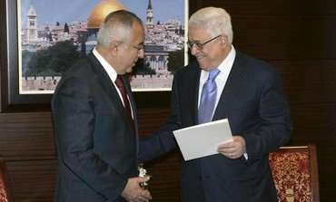 PA Prime Minister Fayyad submits his government's resignation to PA President Abbas, February 2011.