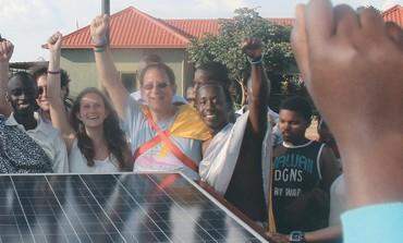 YOSEF ABRAMOWITZ and his daughter Hallel Abramowitz-Silverman install solar panels