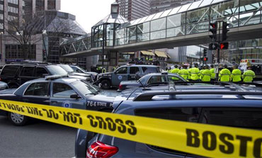 Boston Police coordinate the scene after two blasts at the Boston Marathon, April 15, 2013.