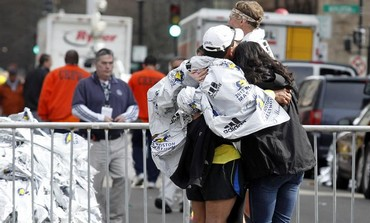 People comforting each other after Boston blast, April 15, 2013.