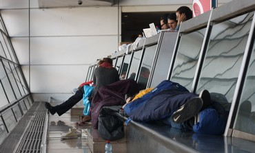 Passengers asleep at Ben Gurion airport during airlines strike, April 22, 2013.