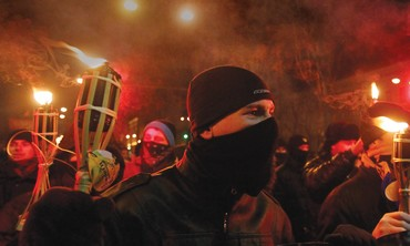 ACTIVISTS OF the Svoboda Ukrainian nationalist party hold torches,  take part in a rally in Kiev.