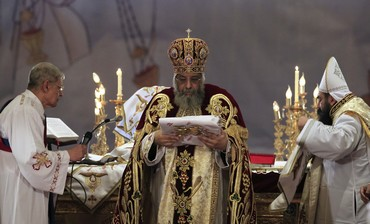 Pope Tawadros II (C), the 118th Pope of the Coptic Orthodox Church of Alexandria and Patriarch of th