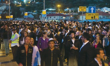 CELEBRANTS REJOICE during Lag Ba'omer festivities on Mount Meron in the Galilee yesterday.