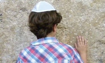 Boy prays at Western Wall.