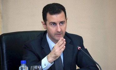 Syrian President Bashar Assad heading a cabinet meeting in Dam