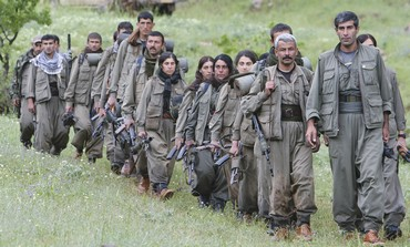 KURDISTAN WORKERS PARTY (PKK) fighters walk on the way to their new base in northern Iraq on Tuesday