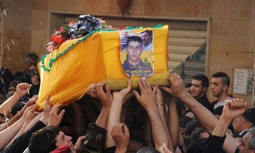 Supporters of Hezbollah, carry the coffin during funeral in Nabi Sheet near Baalbeck May 20, 2013.