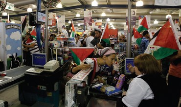 PRO-PALESTINIAN PROTESTERS at an Israeli supermarket in the West Bank.