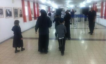Haredi family crossing back into Israel from Jordan