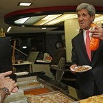 US Secretary of State John Kerry samples some dessert, Ramallah, May 23, 2013.