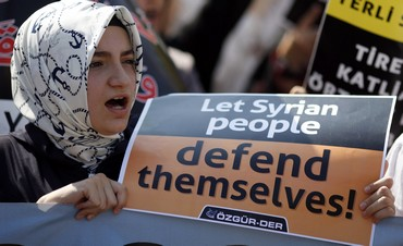 Woman shouts slogans during protest against Assad