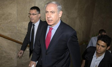 Netanyhau arrives for weekly cabinet meeting at his office in Jerusaelm, May 26, 2013