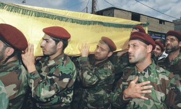 Hezbollah members at funeral of a Hezbollah fighter, May 25, 2013
