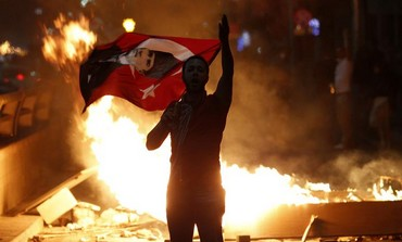 Anti-government protester holds a Turkish flag during a demonstration in Ankara, June 2, 2013.