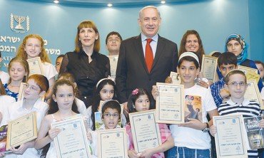 PRIME MINISTER Binyamin Netanyahu and Culture Minister Limor Livnat award reading certificates