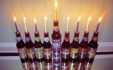 Menorah made of Shmaltz Brewing's He'Brew beer bottles