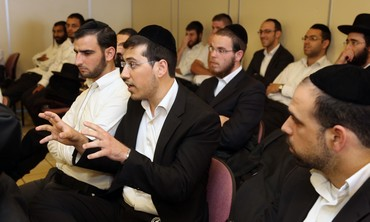 Ultra-Orthodox men at question and answer session with Economy and Trade Minister Naftali Bennett.