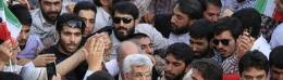 Supporters crowed around Iranian presidential candidate Saeed Jalili during a rally in Tehran