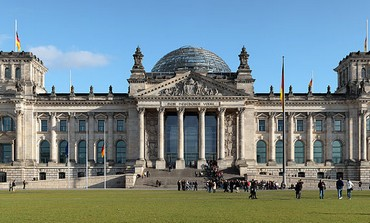 "The Reichstag building seen from the west. Inscription translates to ""For/To the German People"""
