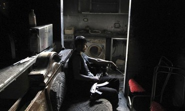 A Free Syrian Army fighter rests in an Aleppo apartment.