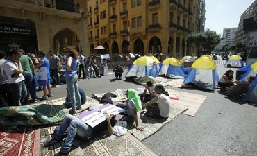 Protesters stage a sit-in demonstration near the parliament building in Beirut, June 21, 2013.