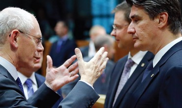 EC President Herman Van Rompuy speaks to Croatia's Prime Minister Zoran Milanovic in Brussels.