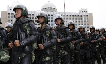 Armed paramilitary policemen in Xinjiang