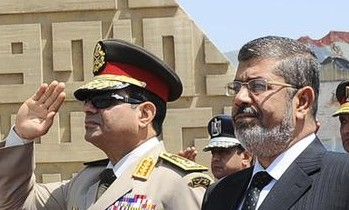 Egypt'sChief of Staff Abdel Fattah al-Sisi (R) and Egyptian President Mohamed Morsi in April, 2013.