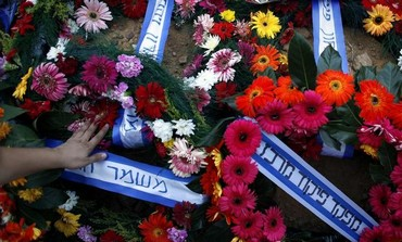 A wreath placed on the grave of police officer Yehoshua Sofer during his funeral in Beersheba June 1