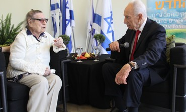 Shimon Peres with holocaust survivor Mira Shoval.