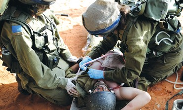Soldiers take part in a medical drill.