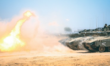 Tanks fire rounds as part of an intensive 'master gunner' course.