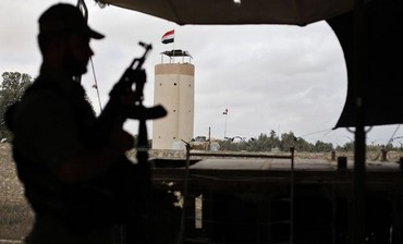 A Palestinian officer on alert near the border with Egypt