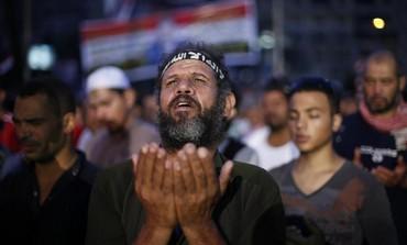 A supporter of deposed Egyptian President Mohamed Morsi attends night prayers